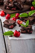 foto of cherry  - Chocolate brownies with cherries homemade with just picked cherries and mint