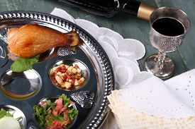 picture of seder  - Matzo for Passover with Seder meal and wine on plate on table close up - JPG