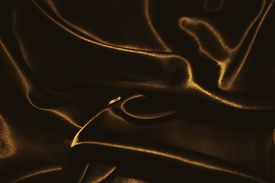 image of rayon  - delicate waves of golden satin silk close up - JPG