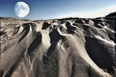 Surreal Moonscape From Combined Photographs Of Sandy Beach And Moon