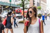Urban city lifestyle hipster asian woman drinking healthy fruit vegetable berry juice smoothie walki poster