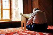 Prayer in mosque, reading Koran