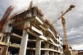 stock photo of erection  - Construction site with crane and building - JPG