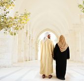 stock photo of soulmate  - Muslim arabic couple walking together - JPG