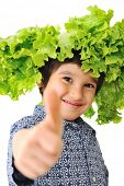 Kid with salad wig on head, rising thumb up