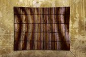 Grunge background with bamboo mat