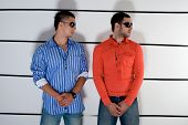 a couple of suspicious delinquents in police station in line up