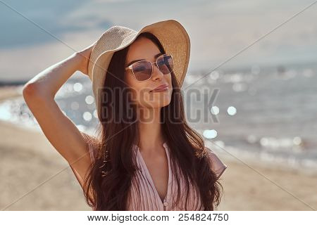 poster of Portrait Of A Smiling Beautiful Brunette Girl With Long Hair In Sunglasses And Sunglasses Wearing A