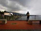 Man Looks Out Towards The Sorrento Coastline On A Gloomy Day poster