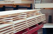 Planks Of Stacked Boards, Ready To Be Used In Carpentry. Polished And Stacked Wooden Boards, In A Ca poster
