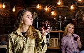 Friends On Relaxed Faces In Plaid Clothes Relaxing, Defocused. Girls Relaxing And Drinking Mulled Wi poster