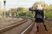 Beautiful Young Girl Is Hitch Hiking On Railroad