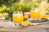 Glass Of Fresh Orange Juice,ripe Orange Fruit And Slices On Natural Table.freshly Squeezed Orange Ju poster