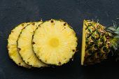 Ripe Pineapple Sliced In Pieces, Top View. Flat Lay Composition With Fresh Sliced Pineapple On Blue  poster