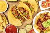 An Overhead Photo Of An Assortment Of Various Mexican Dishes, Including Tacos, Guacamole, Pico De Ga poster