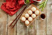 Beautiful Philadelphia Sushi Roll Set with Salmon, Soft Cheese and Whipped Cream on Wooden Rustic Ba poster