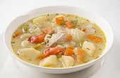 foto of chinese parsley  - Fresh vegetable soup with chicken close up - JPG