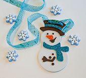 Snowman with cake snowflakes