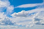 Blue Sky Background With White Dramatic Clouds And Sunlight. Sky Landscape Scene. Sky Landscape Of B poster
