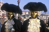 stock photo of venice carnival  - View of a couple dressed in costumes at the Venice Carnival - JPG