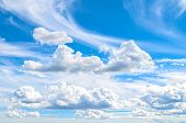 Blue Sky Background With White Dramatic Colorful Clouds And Sunlight. Beautiful Sky Landscape View.  poster