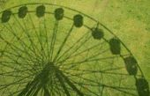Shadow Of Ferris Wheel (fairground Big Wheel) On The Grass In Worthing, West Sussex, England poster