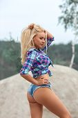 Beautiful Blonde Girl With Perfect Butt Posing Outdoor In Sexy Short Jeans Shorts. poster