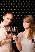 Two Beautiful Brunettes Tasting Wine.