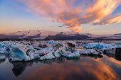 Icebergs In Jokulsarlon Glacier Lagoon. Vatnajokull National Park, Iceland Summer.midnight Sun. poster