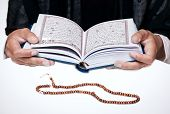 picture of sufi  - young muslim girl reading the Koran in mosque - JPG
