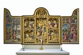 stock photo of triptych  - Catholic triptych inside a church on white background - JPG