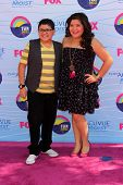 LOS ANGELES - JUL 22:  Rico Rodriguez, sister Raini arriving at the 2012 Teen Choice Awards at Gibso