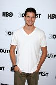 LOS ANGELES - JUL 22:  Robbie Amell arrives at the 2012 Outfest Closing Night Gala of