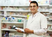 cheerful pharmacist chemist woman standing in pharmacy drugstore