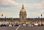 PARIS - JUNE 06: Traffic on Alexander III bridge near Les Invalides complex containing museums, monuments, veteran hospital and thumb of Napoleon Bonaparte in Paris, France on June 06, 2012.