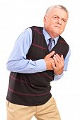 picture of heartbreaking  - Mature man having a heart attack - JPG