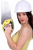 Woman holding up a crosscut saw