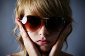 Blond Girl With Large Sunglasses