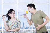 Boyfriend shout at girlfriend with megaphone