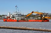 foto of dredge  - Ship with working excavator on board - JPG