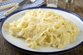Fettuccine Alfredo on a rustic table