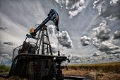 pic of oilfield  - Oil pump industrial machine for petroleum in the sunset background - JPG