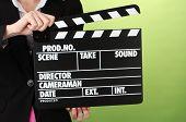 Film Production Clapper Board auf farbigem Hintergrund