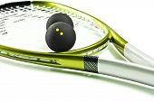 Green and silver squash racket and ball on a white background with space for text