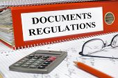 stock photo of policy  - file folder marked with documents and regulations - JPG