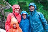 Family On Mountain Trail On A Rainy Day