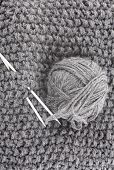 Ball Of Wool For Knitting And Needles On The Knitted Items