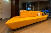 huge yellow orange couch