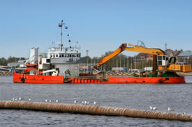 stock photo of dredge  - Ship with working excavator on board - JPG