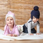 stock photo of knitwear  - Little kids dressed in warm knitwear for cold weather - JPG